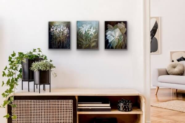 Flowers vertical paintings over table