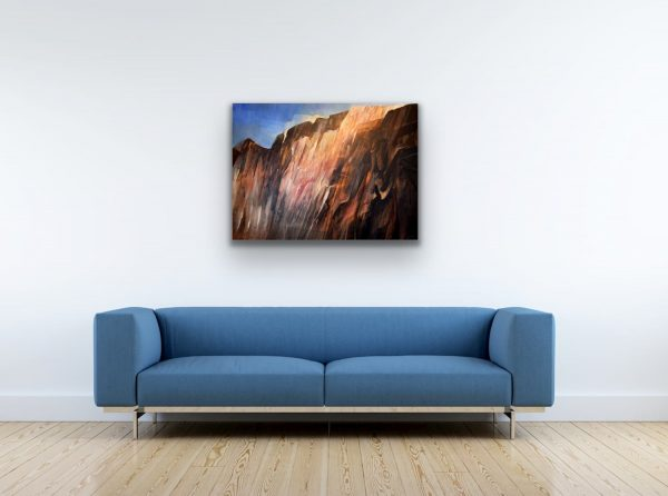 Mountain light - abstract contemporary painting of mountains landscape above blue sofa